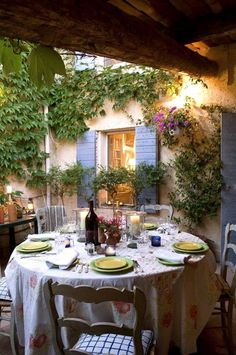 romantic/ oh such a perfect setting for an enjoyable meal, great color shutters, wall color is great, vintage look tablecloth