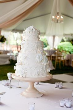 White cake with intricate white flower and vine detailing.     Photography by kimgraham.net/, Event Planning