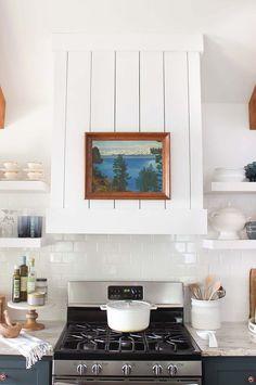 Shiplap hood with vintage landscape painting #shiplap #kitchen