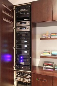 Equipment rack neatly conceals home automation system electronics gear - more smart home ideas in our Inspiration Gallery!
