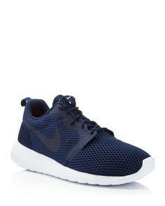 A streamlined and breathable mesh upper gives the Roshe One from Nike an all-day comfort and a statement-making style. | Mesh/synthetic/rubber | Imported | Fits true to size, order your normal size |