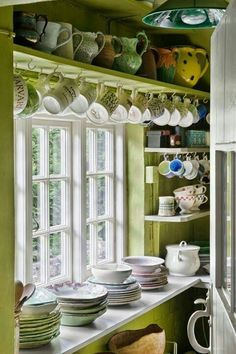 I like the display above the window. However, I think Teapots on top and teacups below would be charming!