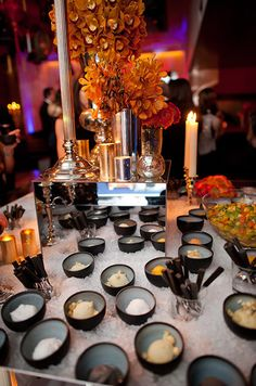 A bed of ice which previously displayed an array of sushi transforms into a delicious gelato dessert station.