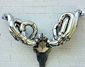 Auto Antlers- Race headers and stainless steel imitating a deer or ram mount... This is just too cool for the Man Cave!