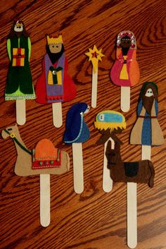 Vilten kerstfiguren op stokje