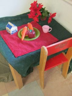 """Waiting for Santa role play at Kidsunlimited Callands. *** Candy Floss says """"This Poinsettia is plastic because the sap in the real ones are an a irritant and should be kept out of children's reach"""""""