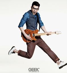 Kim Woo Bin. I love this picture of him; he looks like he's really a geek rocking out.