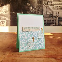 """Keep Swimming Card. Cardstock & vellum: Folia; stencil: Rayher (""""Drops""""); stamps: Altenew (""""Ori Kami""""); ink: Memento, SU; sentiment: MME (""""Market Street Ashbury Heights Collection Pack""""); enamel dots: Simple Stories; Wink of Stella (clear)."""