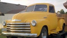 An old classic yellow truck.