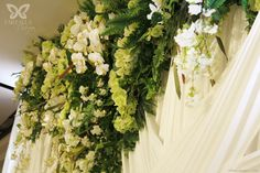 White Draping with Ferns, Orchids and Greenery decor  http://partydesign.com.au/