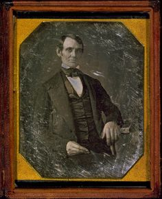 Abraham Lincoln, Congressman-elect from Illinois. Three-quarter length portrait, seated, facing front (1846/7; earliest known photograph of Lincoln)