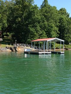 North Georgia Boat Lift & Marine Construction Company completed installation on a beautiful CAT 3 dock at Lake Chatuge, right in time for the 4th of July! Fitted with a single-slip combined with a wide-side, this dock features Ironwood decking. A gable roof protects this dock from any hail or persistant rainfall. Two 1/4″ Cables anchor the dock to shore, while a 60′ Arched Gangway anchors to shore! Dock Ideas, Boat Lift, Gable Roof, Boat Dock, Decking, Blue Ridge, Anchors, Georgia, Outdoors