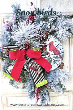 This Christmas wreath is made with beautiful heavily flocked faux pine, beautiful faux iced berries. and a metal sign with two beautiful cardinals. All of this is offset by a beautiful big designer bow. This wreath would be stunning on any front door. If you like country or farmhouse decor, this is your kind of wreath. It also is versatile enough to go with any style home. This wreath will bring jaw-dropping beauty to your front porch, door, mantle, or interior throughout the winter season.
