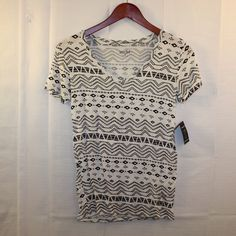 Black & White Tribal Print V-Neck Tee Women's Sz S NWT Black & White Tribal Print V-Neck Tee Women's Size Small * Very Cute & Comfy. * In Great Preowned Condition. No Noted Flaws. * Bundles Available at a 5% discount.  * Please see pictures & ask questions! * Sorry No Trades. Tops Tees - Short Sleeve
