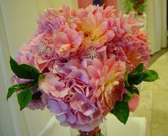 Textural pink bouquet designed with pink ginger, hydrangea and dahlias.