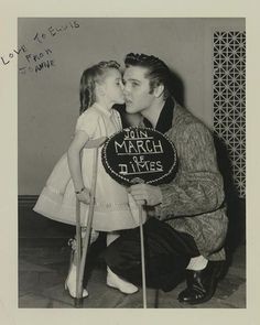 JOANNE WILSON was New York City's March Of Dimes Poster Girl of 1956. Elvis posed with the lovely Joanne on the day that marked his third and final performance on the Ed Sullivan Show. Elvis is wearing the same clothes as during the Sullivan rehearsals, so these photos seem to be taken around the same time