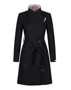 The Ted Baker Khera coat is the perfect addition to your outerwear winter wardrobe. Designed in a staple black, the Khera coat has a flattering silhouette, that will nip you in at the waist with its tie belt. The perfect way to complete any outfit, this coat has been constructed with a warm wool blend and a hint of cashmere for that luxurious finish.