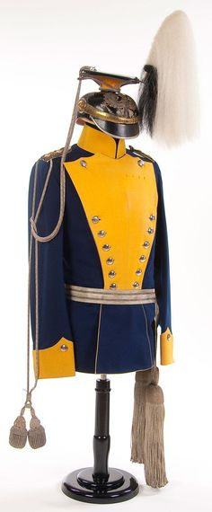 An imperial German Prussian 15th Ulan Regiment Colonel's uniform with helmet, circa 1910. Dark blue wool Ulanka with yellow collar, cuffs and piping. Includes removable plastron front for full dress. Has silver flecked black cord shoulder straps with gold rank pips and unit number on a yellow field. Chapska of black leather with silver eagle plate and visor trim. Has brass chin scales and an officer's pattern national cockade.
