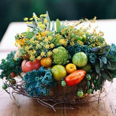 Seasonal Bounty Basket Centerpiece  A wicker basket contains a lush arrangement of the growth of autumn. Put a square of floral foam into the container and add a collection of kale, dill, tomatoes, broccoli, and other harvest finds for a colorful, edible centerpiece.