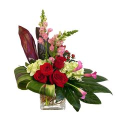 Send flowers in the traditional colors of love – red, pink and white flowers modern style and arranged in a glass cube. This mix of roses, calla lilies, hydrangeas, berries, snapdragons and tropical greens is ideal for both women or men with high style and eclectic taste. Shown here in Deluxe at $90, but available […]