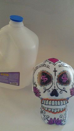 Gallon Jug Sugar Skull Craft. Dia de los Muertos. We used sharpies for the decoration. There is a tutorial for the skull on YouTube - (Upcycled, DIY, Homemade, Reused, Recycled, Plastic, Milk Jug, Water Jug)