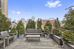 'The deck is surrounded by pine trees and you really think you're living in Italy,' says Mrs. Weinstock. 'We sit down and have a drink in the summer.' The couple designed the roof garden themselves. Mr. Weinstock made the planters for the trees.