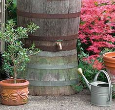 Rain Barrel ideas - Bob Vila  I love the upside down half as the stand for the full.