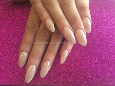 Acrylic nails with natural gel polish and glitter dust