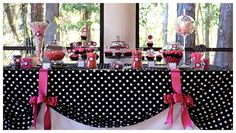 Love the Black & white polka dot table cloth tied up up with the ribbons!
