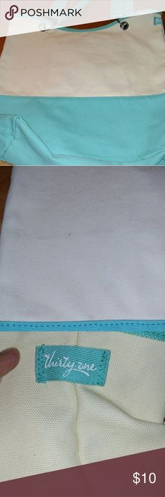 Thirty One Shoulder Bag Purchased last year and used at the Lake... So there is a stain on the front and the back, which I have taken photos for you to see.  Thirty One is such an awesome product and this is a good bag for summer being a cream color and teal blue.  It has a key chain clip inside bag and one pocket that zips up. Thirty One Bags Shoulder Bags