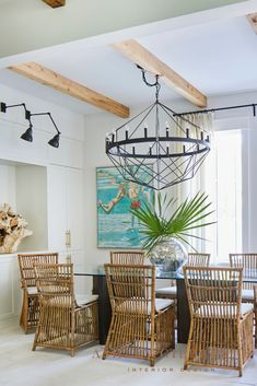 ASHLEY GILBREATH INTERIOR DESIGN: A glass top table seats a crowd but also allows this smaller space to breathe, and an oversized iron chandelier helps the space feel bigger. A painting by Sarah Soule Webb adds a pop of color to the space. Ashley Gilbreath, Rosemary Beach, Design Development, Beach House, Sconces, Interior Design, Iron Chandeliers, Balloon Decorations Party, Table Seating