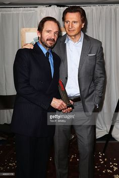 Liam Neeson and Ralph Fiennes with the Empire Legend Award on stage during the Jameson Empire...