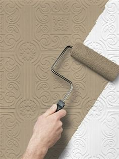 The textured paintable wallpaper i 39 m using beneath our for Textured wallpaper accent wall