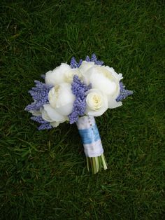 Beautiful unique blue and white bridal bouquet made up of white peonies and muscari flowers, created by Peonies Florist.