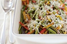 Roasted vegetables are really low tending - simply splash on some flavor and throw them in the oven.  We love roasting green beans like this.  They retain their beautiful color, and develop a warm, smoky flavor.