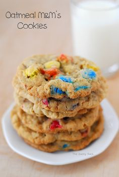 Oatmeal M&M's Cookies are a classic treat. This cookie recipe can be made with chocolate chips or M&M's. Grab a few oatmeal cookies fresh out of the oven with a glass a milk and it takes you back to when you were a kid! Bake Sale Cookies, M M Cookies, Filled Cookies, Oatmeal Cookies, Chocolate Chip Cookies, Chocolate Chips, Sugar Cookies, M&m Cookie Recipe, Cookie Flavors