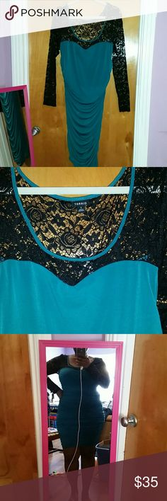 Ruched body con dress Teal and black dress with ruching. Lacy shoulder panels, with semi boat neck. This dress is hot and really looks good on. Never worn out, only tried on, brand new no tags. torrid Dresses