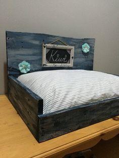 Preciosa cama de palets para perros
