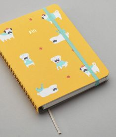 A pug-covered personalized planner.