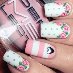 Floral polka dot manicure with a metallic heart nail stud