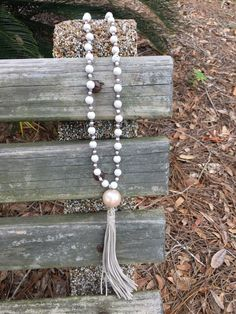 A personal favorite from my Etsy shop https://www.etsy.com/listing/483186709/wood-bead-tassel-necklace-with-faux