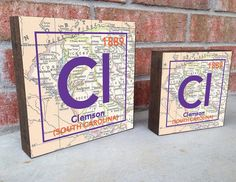 Clemson University Tigers - Clemson, SC - Periodic Vintage Map Art Print on Wooden Block *Date in right hand corner is the establishment date. Enjoy these fun periodic signs of your city! These vintag