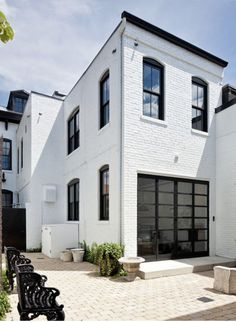 Brick painted white, black steel framed windows