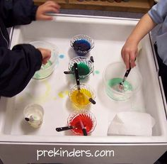 Mixing Goop in the Sensory Table