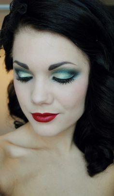 She reminds me of Snow White in this pic, love the make up !