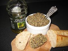 5 minute tapenade.    1 (6.25 oz) jar pitted country mix olives  1 (6 oz) can pitted black olives  A couple spoonfuls of pimento-stuffed manzanilla olives  1/2 of a 4 oz jar capers  Zest of 1 lemon  3 T. fresh or dried parsley  Olive oil    place drained olives and capers in food processor.  Add lemon zest and parsley; process a few seconds to chop and blend ingredients together.  Drizzle in olive oil until tapenade reaches your desired consistency. Serve with bread or crackers.