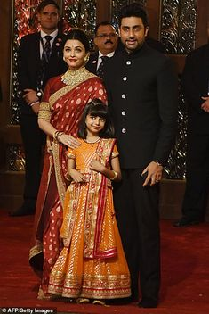 Indian Bollywood actors Aishwarya Rai Bachchan and Abhishek Bachchan with daughter Aradhya pose for a picture as they attend the wedding ceremony of Indian businesswoman Isha Ambani with Indian.