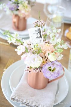 This gorgeous Mother's Day flower arrangement serves as a guest card, table decor and a take home favor