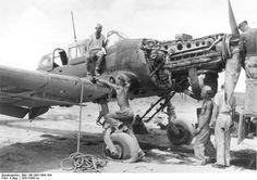 German mechanics disassembling a Ju 87 Stuka dive bomber near Tmimi, Libya, 1941-1943