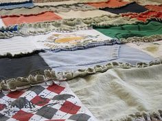 Rag blanket made from old shirts.  A neat idea to try with all the old t-shirts that you have an don't know what to you can do with them.  Goodness knows I have a bunch of those.